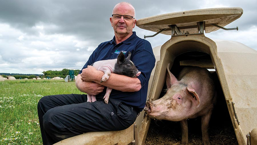 Colin Stone  holding a pig