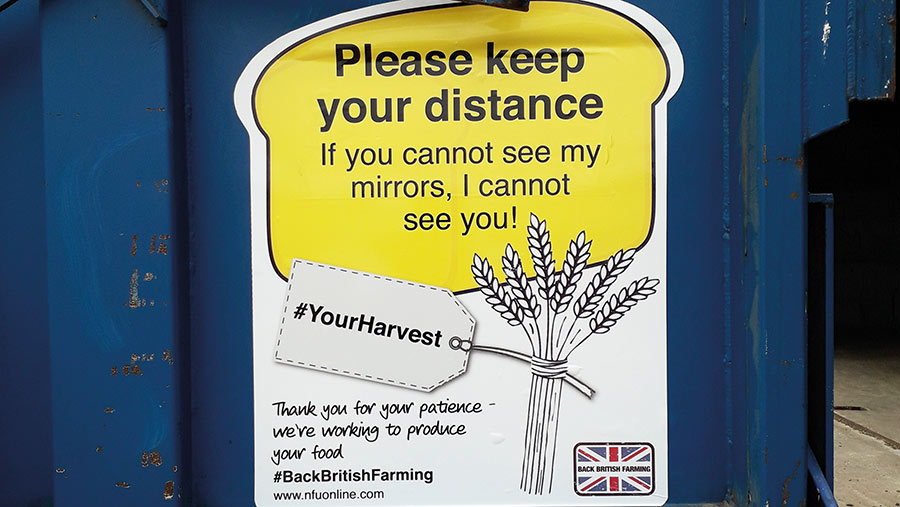 Sticker reads: please keep your distance