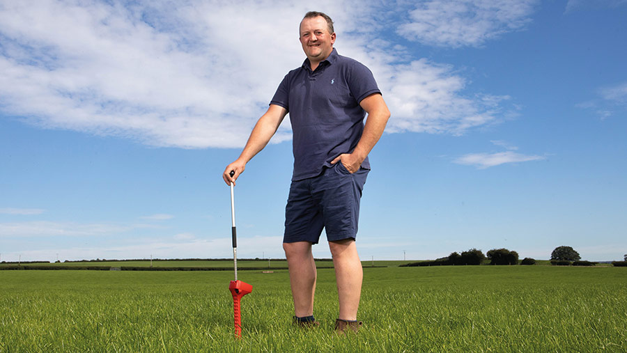 James Muir  in field with grass meter