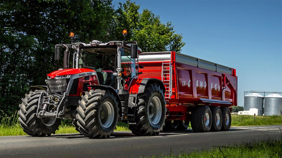 Massey Ferguson 8S tractor with trailer