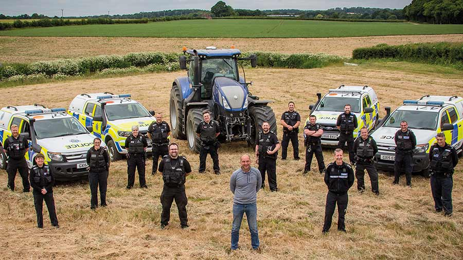 Mark Chandler with police officers and vehicles