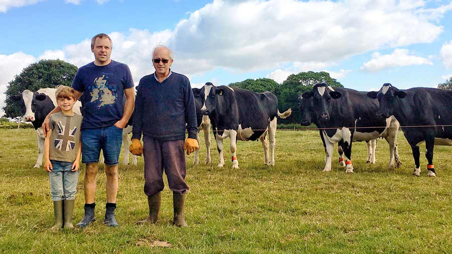 Dairy farmer Nigel-Holiday (centre) with son Archie and father Bernard