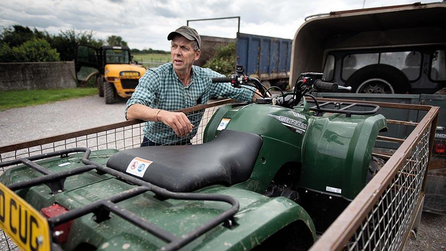 Farmer Richard Willcox with recovered stolen quad bike © NFU Mutual