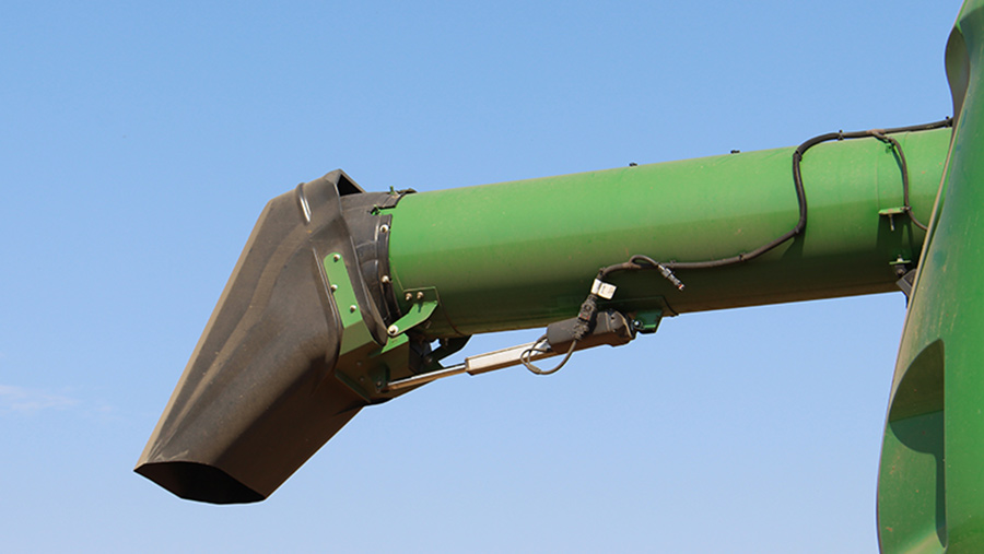 Adjustable spout on auger