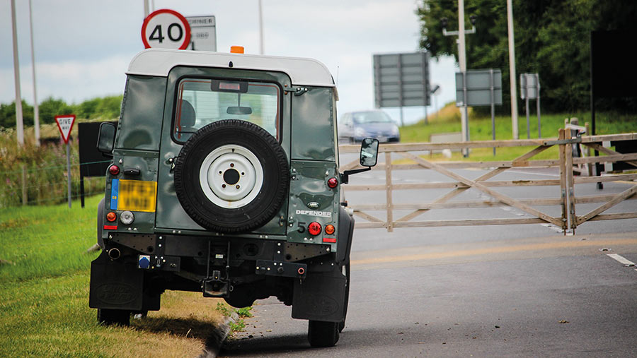 Land Rover Defender on the road
