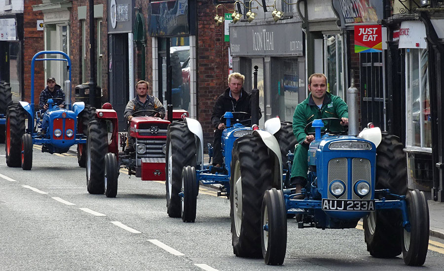 Vintage tractors on the road