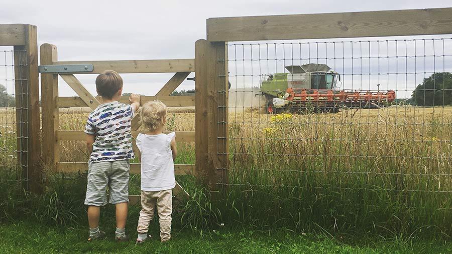 children at farm gate