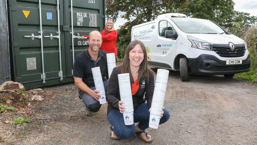 Anna and David Taylor, of Chilly Cow ice cream, with Lisa James, of Container Sales Centre, with the new storage container on the farm where they make the award-winning Chilly Cow ice-cream  © Rick Matthews