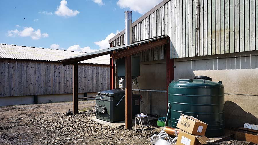 Incinerator positioned under shelter