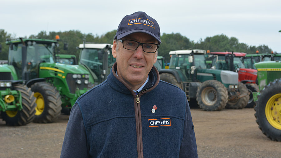 Bill Pepper in front of tractors
