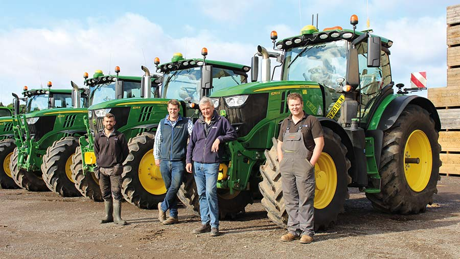 Team in front of machinery fleet at Luffness Mains