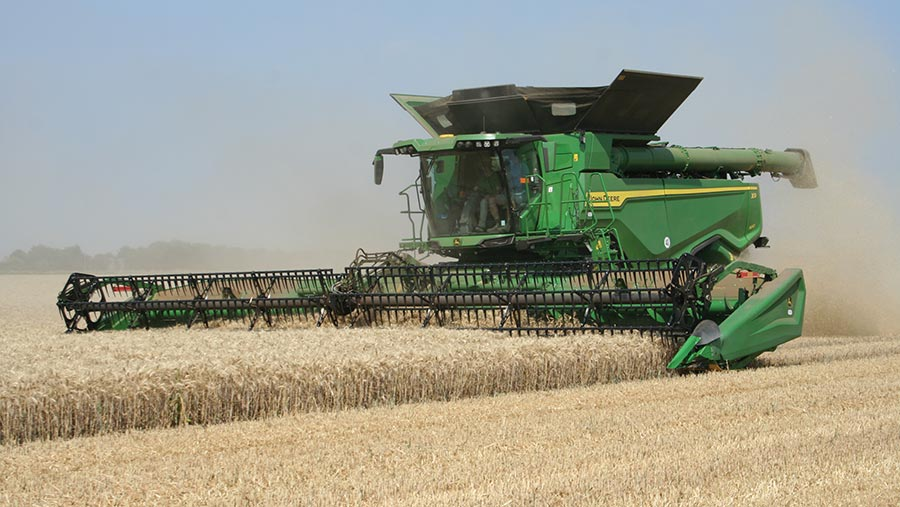 John Deere X9 combine working in field