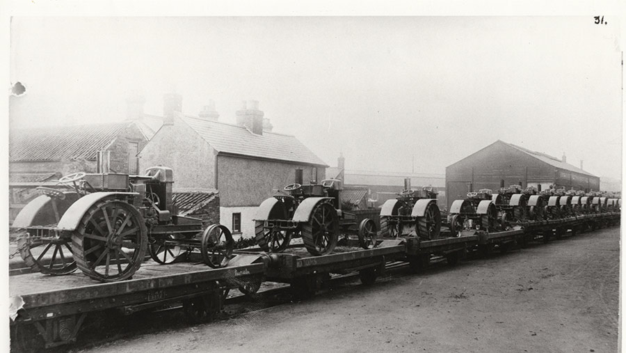Tractors on flatbed railway wagons
