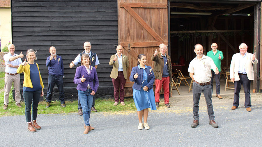 Priti Patel MP with Essex farmers giving a thumbs up to Back British Farming Day