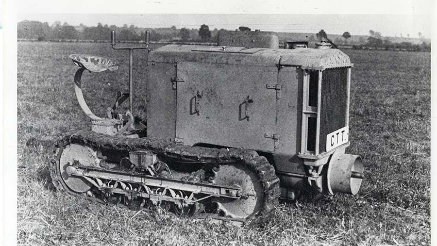 Early tractor in a field