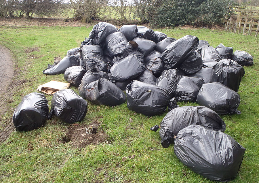 Bags of fly-tipped waste