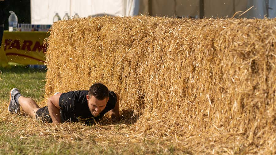 Britain's Fittest Farmer Rob Strawbridge tackles the bales © MAG/Tom Askew-Miller