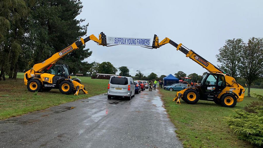 Two telehandlers with banner