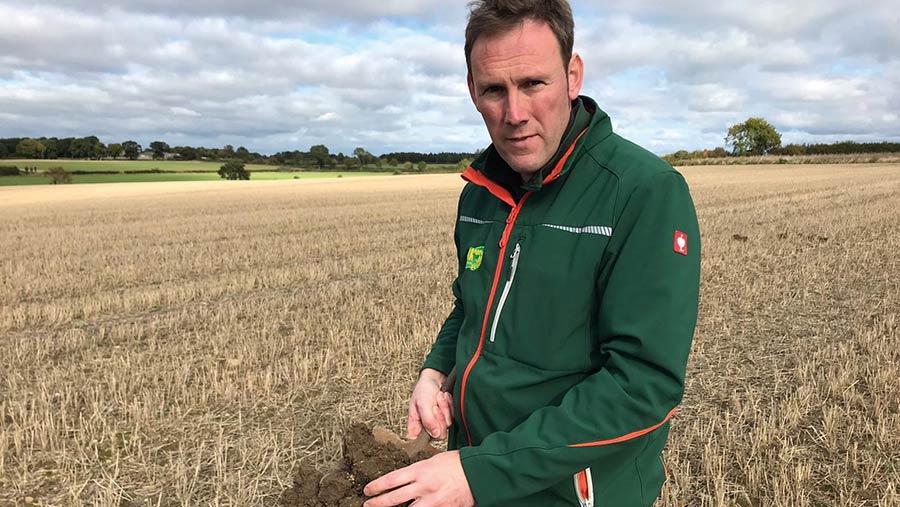 Andrew Yarrow holding soil