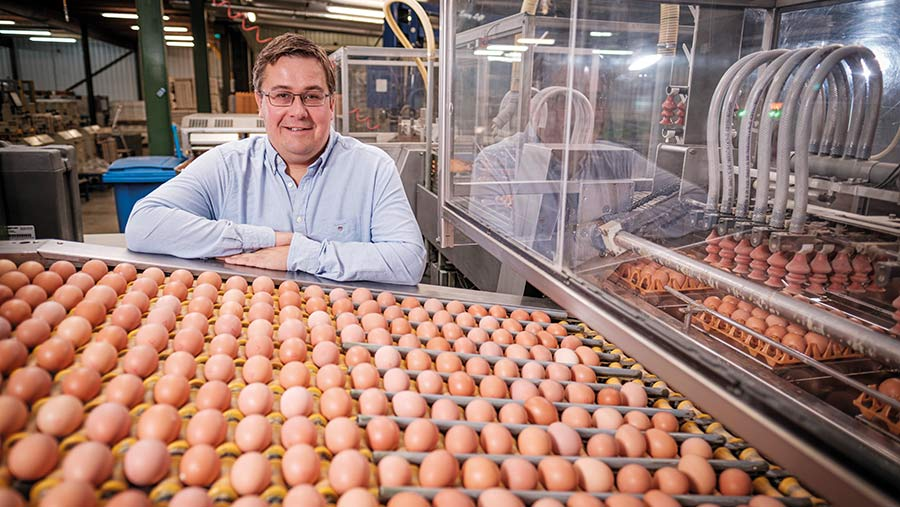 Tom Elliott in shed with eggs