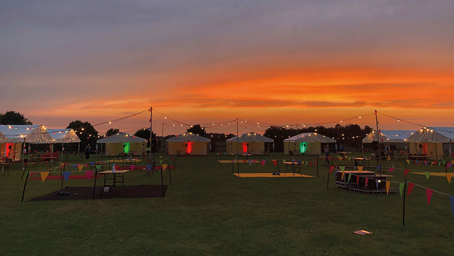 Row of tents in field
