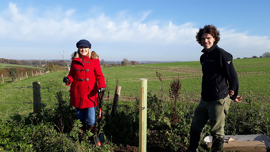 TV presenter Nicki Chapman and SDNPA woodlands officer Bob Epsom planting the first tree for Trees for the Downs