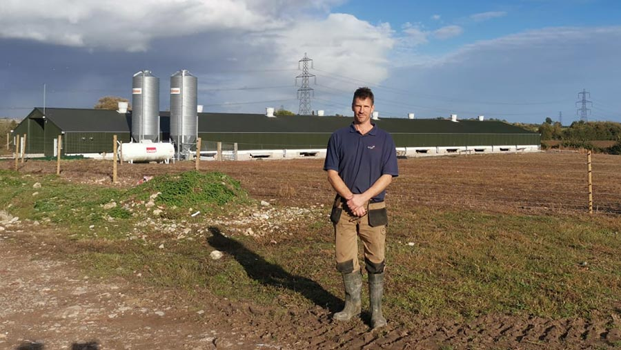 Jon Tydeman with poultry shed in the background