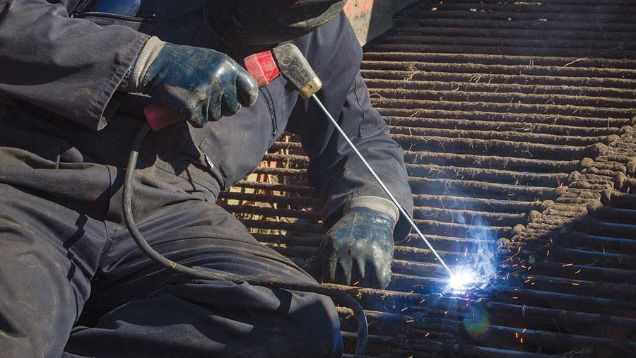 Man welding on roof