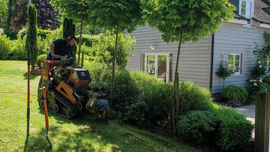 Small machine working to install fibre in residential gardens