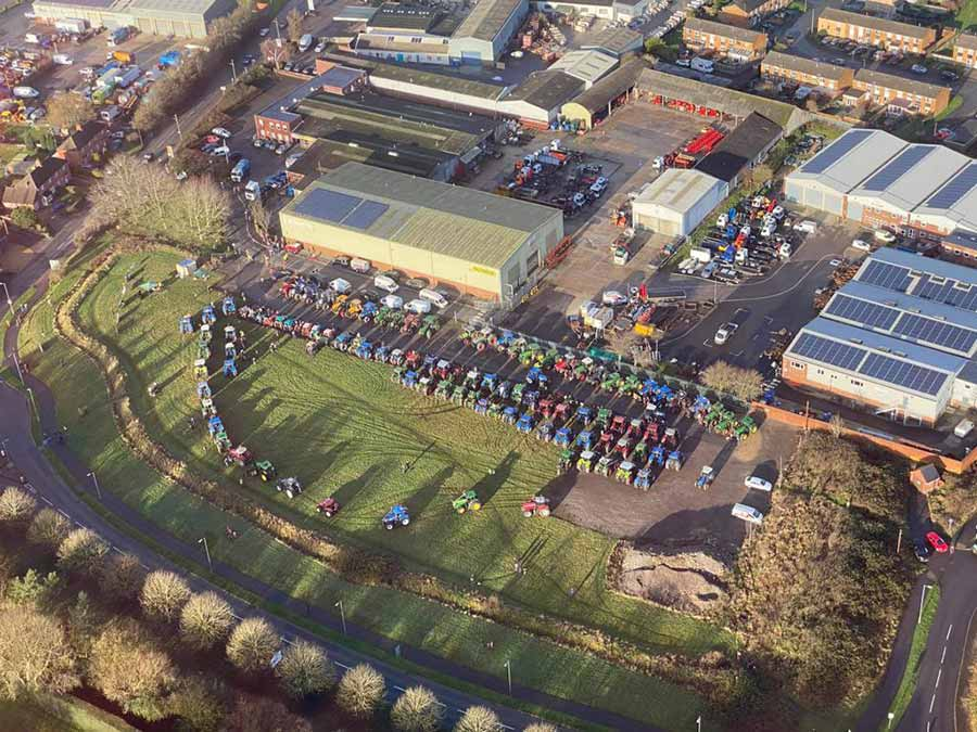 Aerial view of tractors lined up