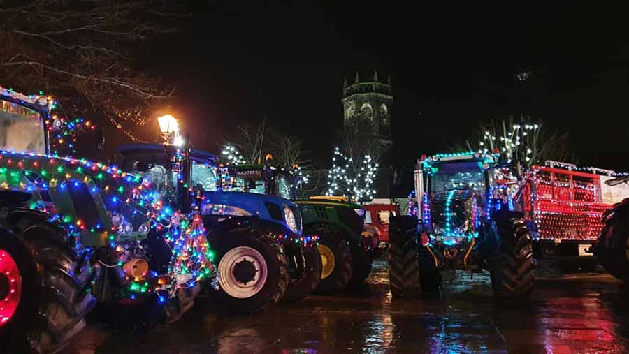 Tractors lit up with Christmas lights