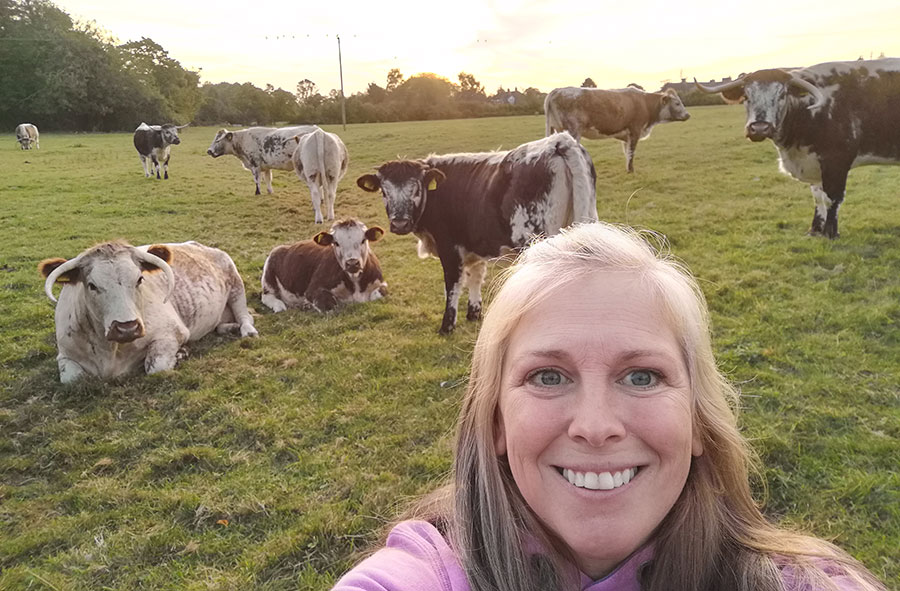 Katie Mitcham takes selfie with cows