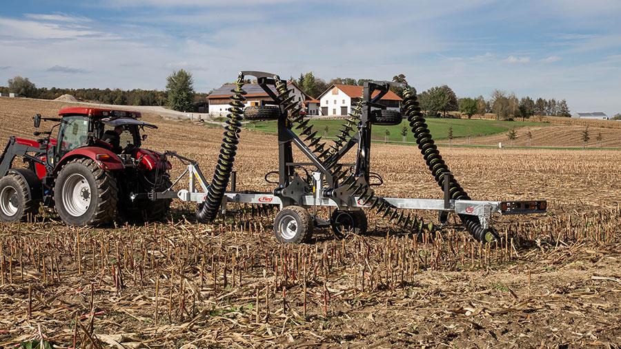 Folded chain harrow in field