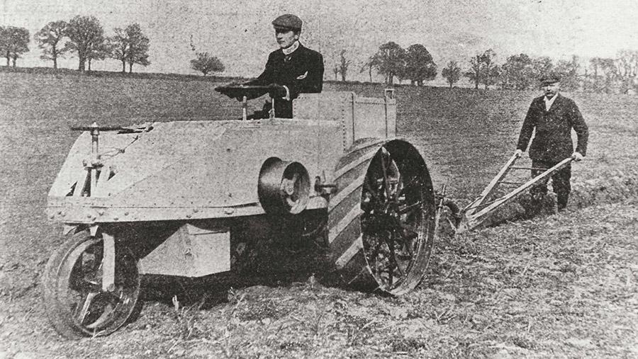 Dan Albone driving one of his Ivel tractors pulling a plough