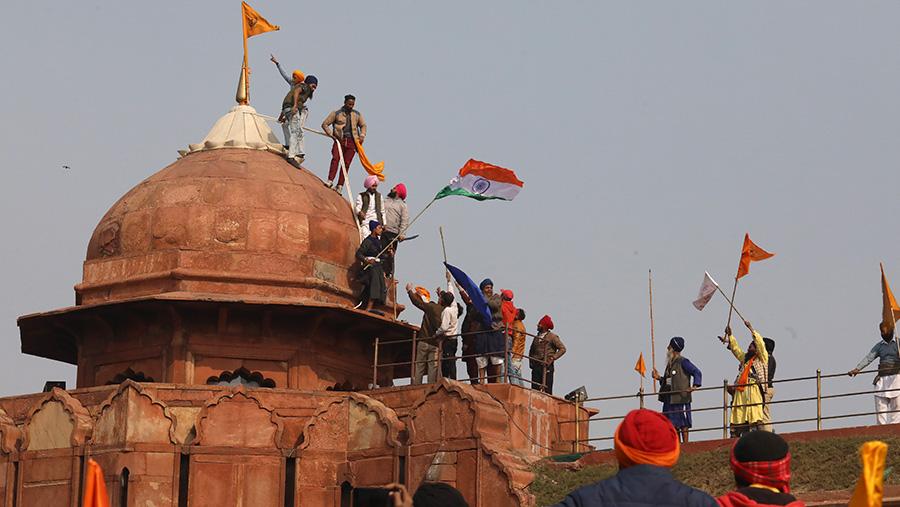 Protestors on temple roof