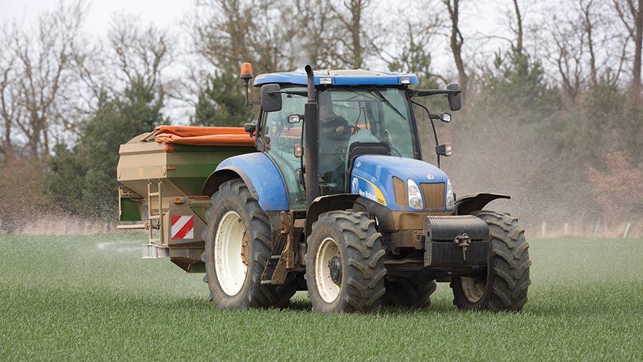 tractor spreading dry fertiliser