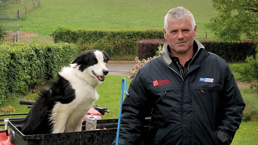 Farmer Gordon Wyeth with his dog and a quad bike