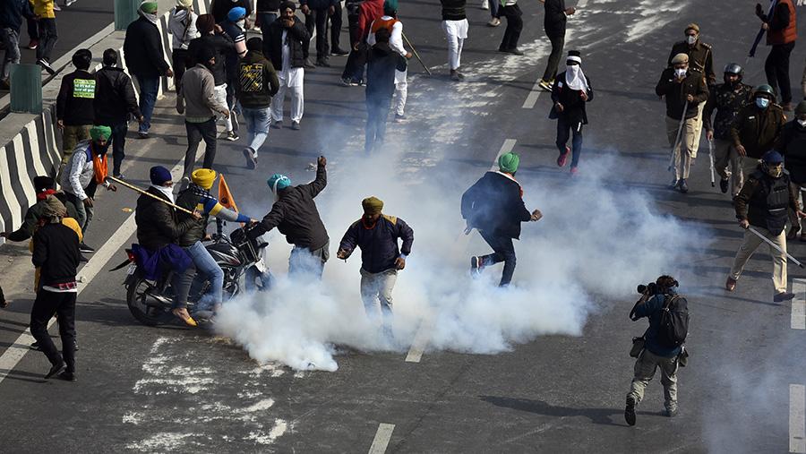 Protestors being teargassed