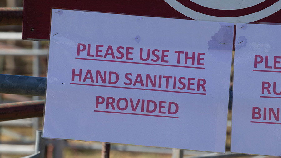 Printed sign reads: Please use the hand sanitiser provided