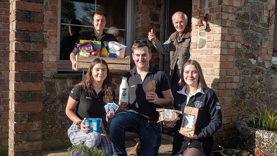 Members of the Probus YFC in Cornwall delivering food to people isolating during the first lockdown © Probus YFC