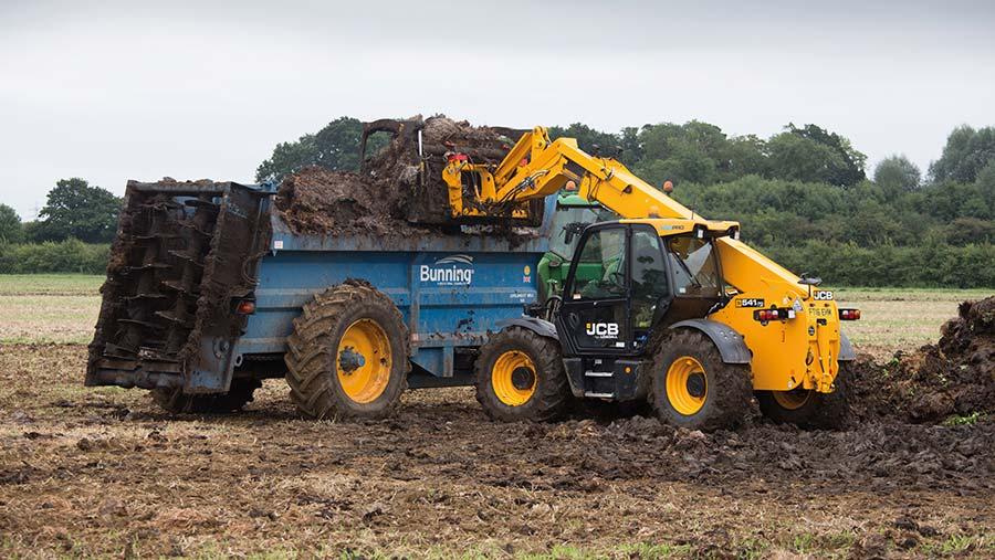 Contractors spreading farmyard manure