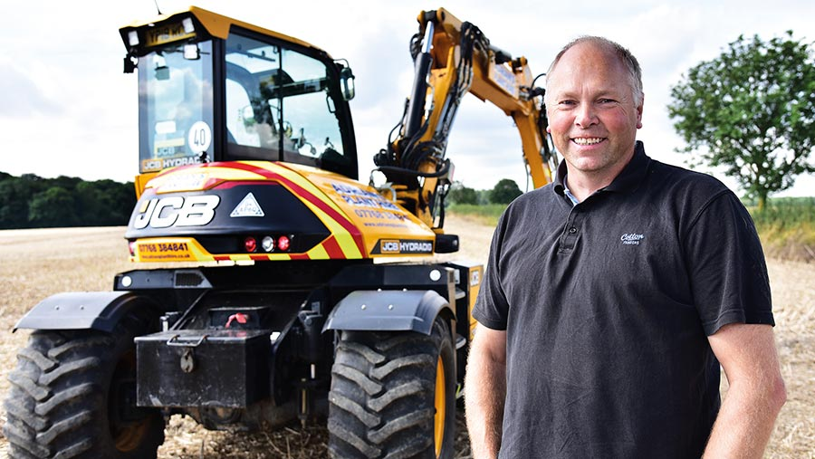 Adrian Patrick in front of JCB Hydradig