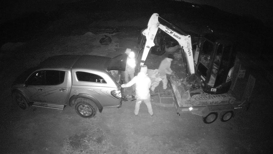 CCTV still of thieves stealing kit