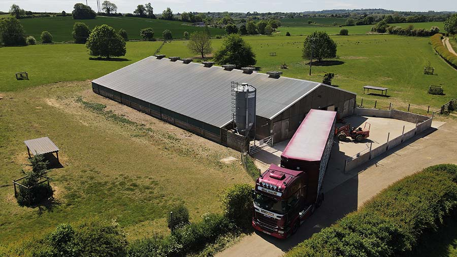 Aerial view of farm shed and an articulated lorry