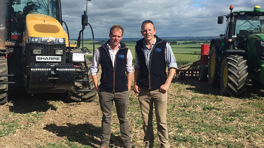 David Hurst and Tom Mead stand in front of machinery