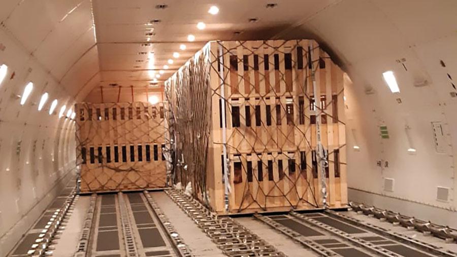 Wooden crates inside an aircraft