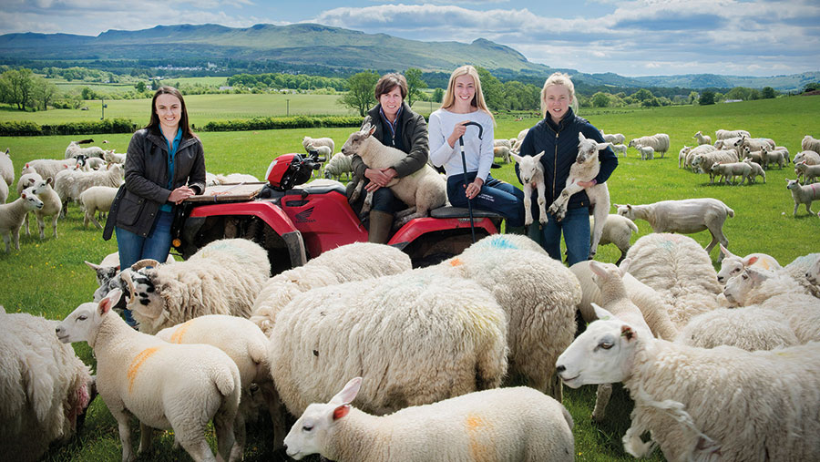 Shona Duncan with her three daughters and the flock