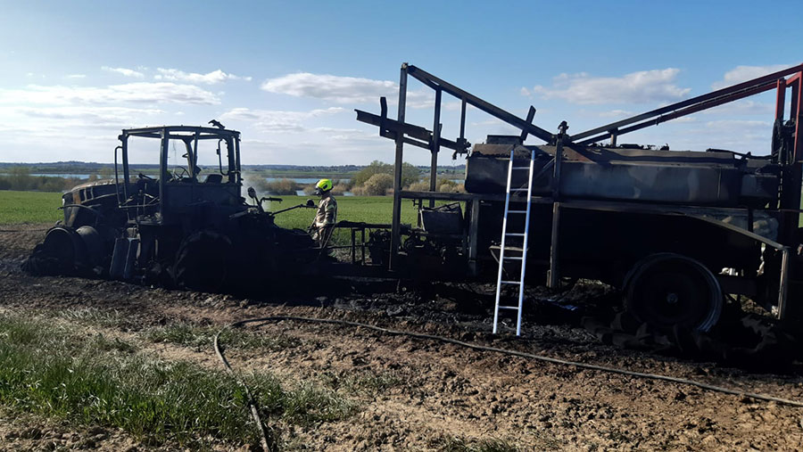 Burnt out tractor on farm