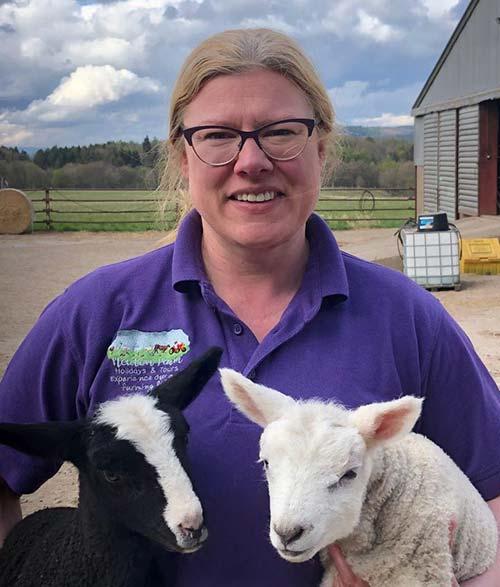 Farmer Louise Nicoll with two lambs