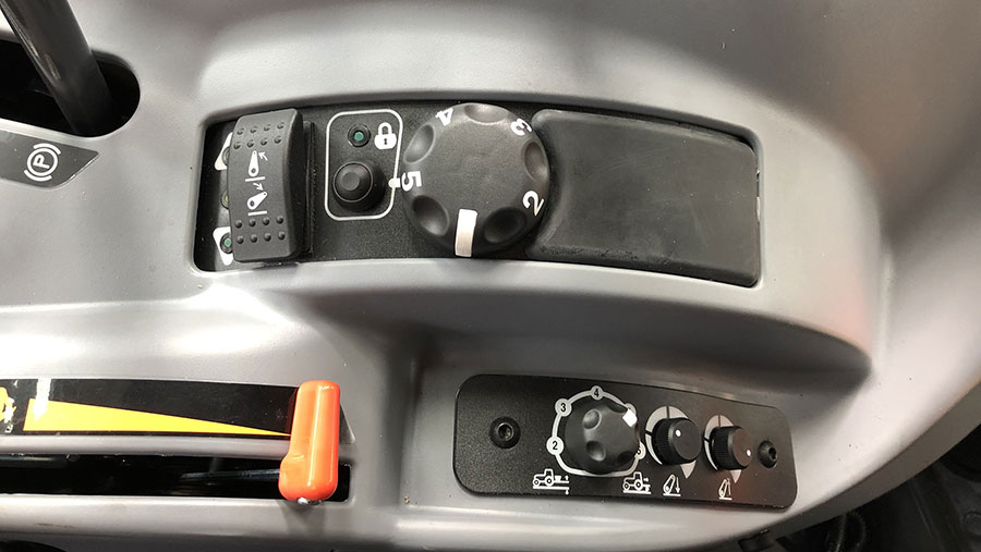 electronic rear lift button in Kubota tractor